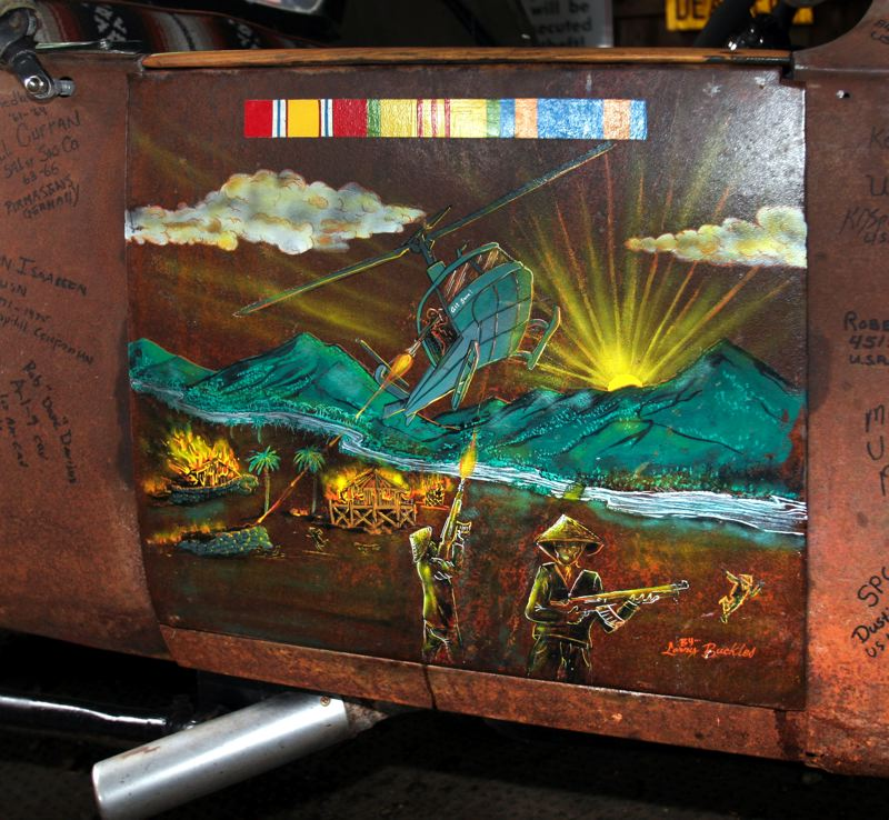 by: OUTLOOK PHOTO: JIM CLARK - Swanson had an artist friend, Larry Buckles of Oregon City, provide the paintings on the doors of his roadster. This one depicts a battle Swanson was in. That's him manning the machine gun in the helicopter.