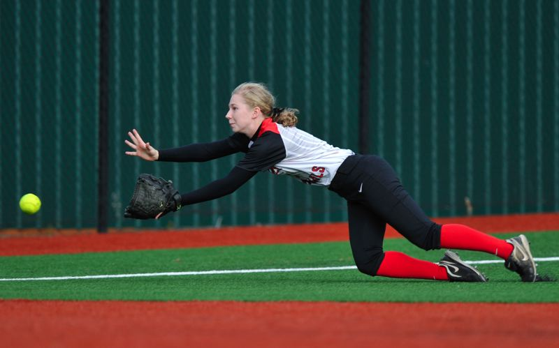 by: COURTESY OF JOHN LARIVIERE - Lincoln's junior left fielder, Kaitlin Larvick, dives for a shallow North Medford hit in the sixth inning Tuesday at Jesuit.