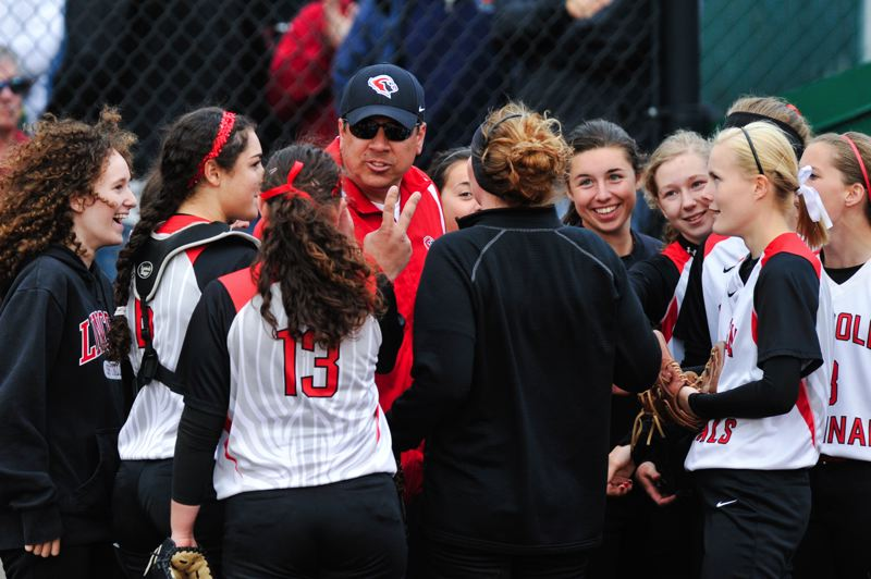 by: COURTESY OF JOHN LARIVIERE - Lincoln softball coach Dennis Muir rallies his team and tells them to get the two runs they need to tie North Medford in the bottom of the seventh inning.