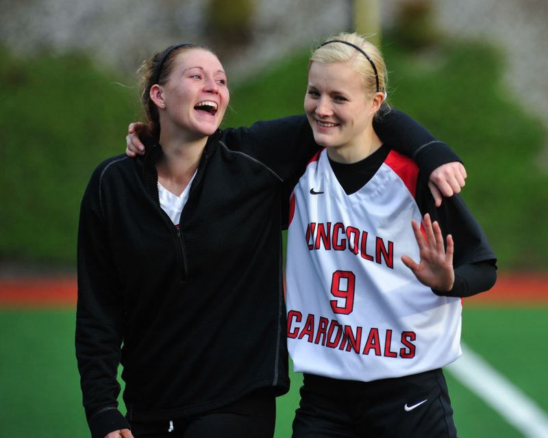 by: COURTESY OF JOHN LARIVIERE - Lincoln High seniors Courtney Huston (left) and Morgan Ashton walk off the field at Jesuit on Tuesday after the Cardinals' season ended at 25-4 in the Class 6A semifinals.