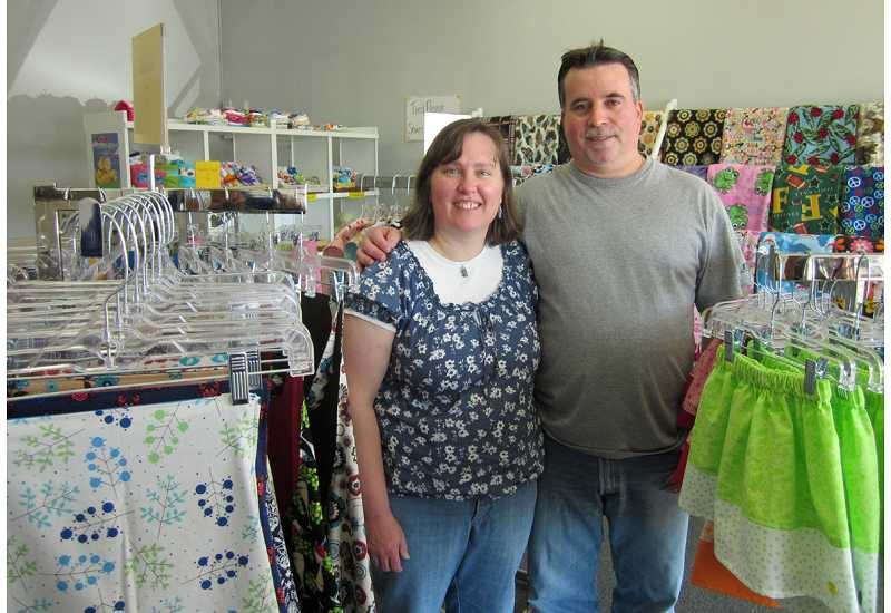 by: BARBARA SHERMAN - DOUBLE DUTY - Robbie and Michael Weber recently opened Robbie's Korner in the King City Plaza that features dozens of items made by Robbie, ranging from swaddling blankets to adult bibs to protect clothing, all created from fun fabrics.