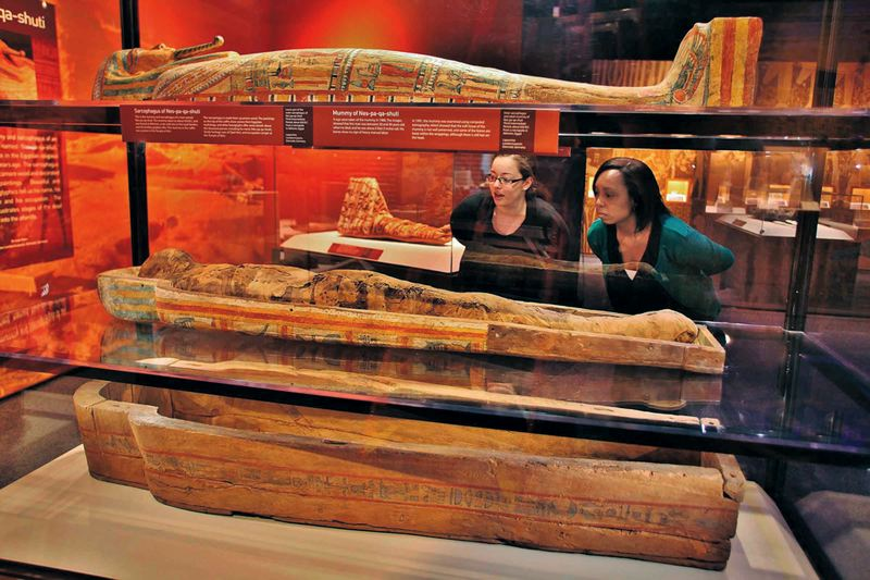 by: COURTESY OF DARRYL MORAN - The mummy of sarcophagus of an Egyptian priest, Nes-pa-kai-schuti, tell the story of intentional mummification; the sarcophagus is made from sycamore wood and decorated with detailed paintings, hieroglyphics tell us his name, heritage and occupation.