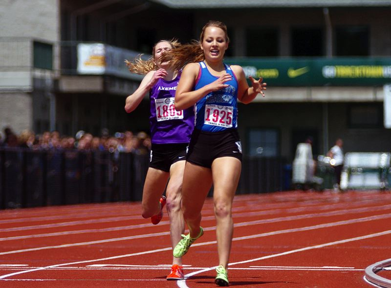 by: PAMPLIN MEDIA GROUP: DAN BROOD - PaIge Rice of St. Mary's Academy edges South Eugene's Erin Clark for first place in the 6A 1,500 meters Saturday at Hayward Field.