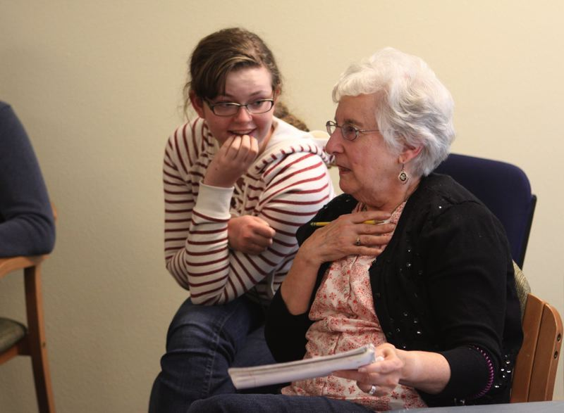by: PHOTO BY: KONSTANTIN MOSKALENKO - Pictured working together on the Voices of Our Elders project is Rex Putman High School junior Amy Loynd and Helen Reasoner.