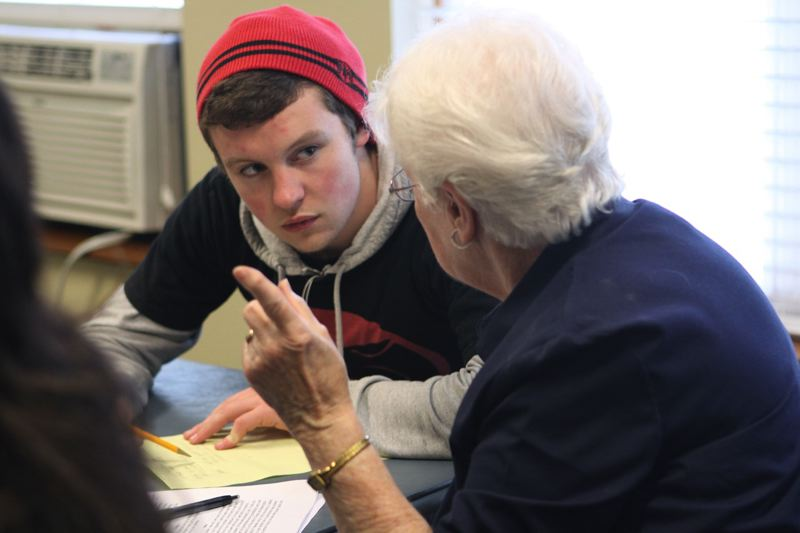 by: PHOTO BY: KONSTANTIN MOSKALENKO - Rex Putnam High School junior Colton Merris is working as the scribe to tell the stories of Irma Morisky.