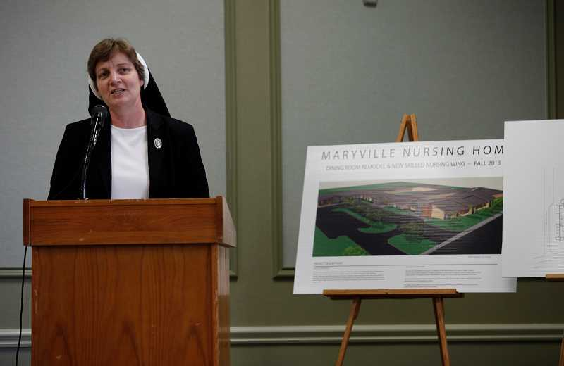 by: TIMES PHOTO: JONATHAN HOUSE - Sister Adele Marie Altenhofen details plans for an expansion of the Maryville Nursing Home as the center celebrated five decades.
