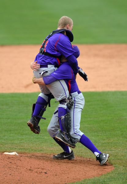 by: COURTESY PHOTO: KELLY BIRD LINFIELD ATHLETICS  - Linfield senior catcher and former Sunset Apollo Kyle Chamberlain celebrates the Wildcats 4-1 National Championship win over South Maine.