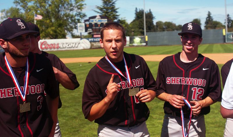 by: DAN BROOD - WE'RE NO. 1 -- Sherwood senior Jacob Urbach (center) knows the Bowmen finished in the top spot in the state.