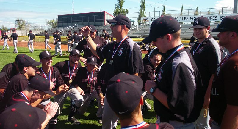 by: DAN BROOD - VICTORY SPEECH -- Sherwood High School baseball coach Jon Strohmaier talks to his team following the state title-game win.