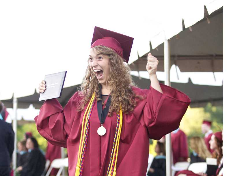 by: JAIME VALDEZ - Mikaela Doherty shares her enthusiasm to family and friends after receiving her diploma during Sherwood High School's graduation at Aaron J. Contreras Memorial Stadium.