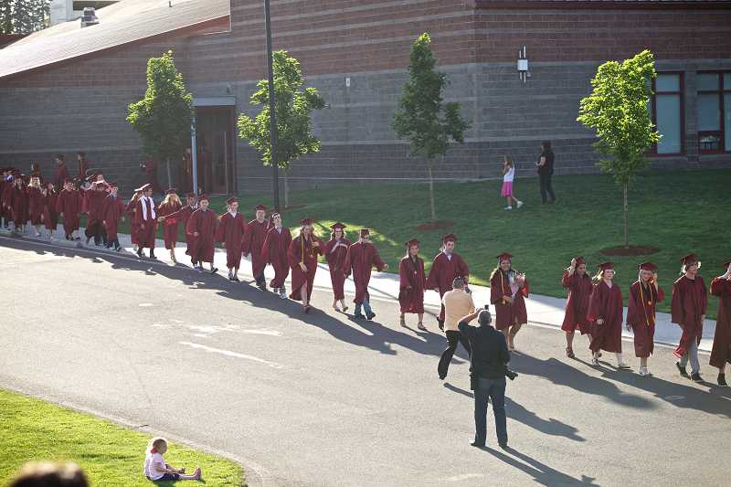by: JAIME VALDEZ - Sherwood High School seniors prepare to march into the school's athetic field during graduation ceremonies June 7.