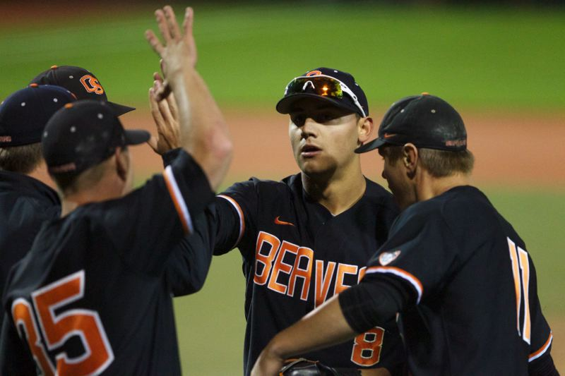 by: TRIBUNE PHOTO: JAIME VALDEZ - Teammates greet Oregon State left fielder Michael Conforto after his on-target throw to home nailed a Kansas State runner trying to tie the score in Game 3 of the super regional at Corvallis. OSU went on to win 4-3, earning a spot in the College World Series.