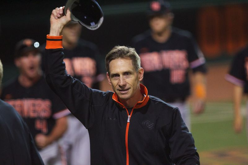 by: TRIBUNE PHOTO: JAIME VALDEZ - Oregon State coach Pat Casey doffs his cap to the Goss Stadium crowd after the Beavers' 4-3 win over Kansas State on Monday clinched a spot in the College World Series.