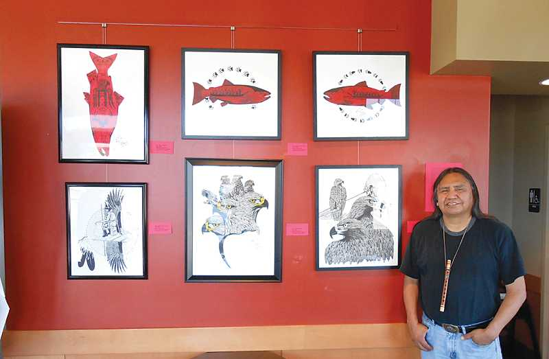 Artist Foster Kalama with some of his pieces.