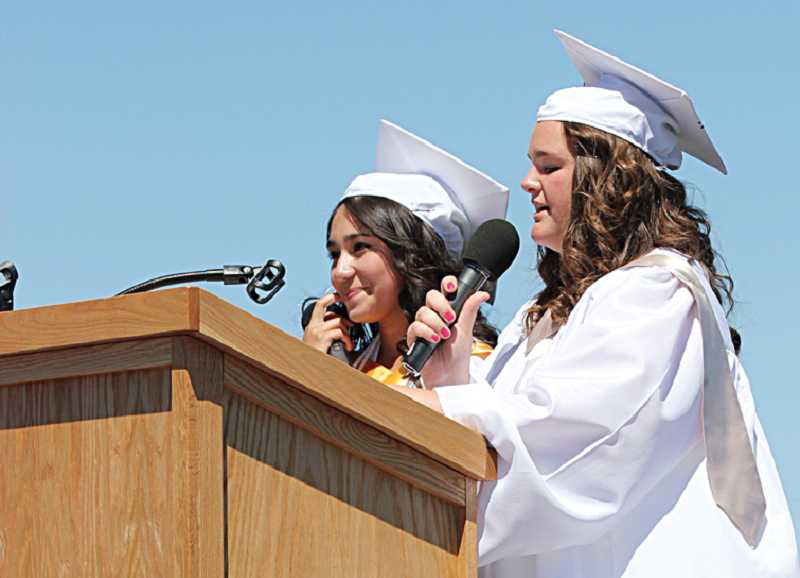 by: HOLLY M. GILL - Senior speakers Stephanie Garcia, left, and Kaitlyn Carter address their MHS classmates at graduation June 8.