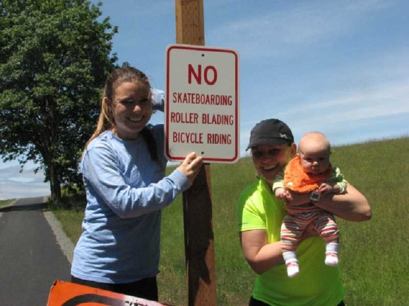 by: SUBMITTED - Kathleen Minor, left, and her sister Sara Hake, along with Hake's baby daughter Annabelle, are helping to break in the new Rosemont Trail.