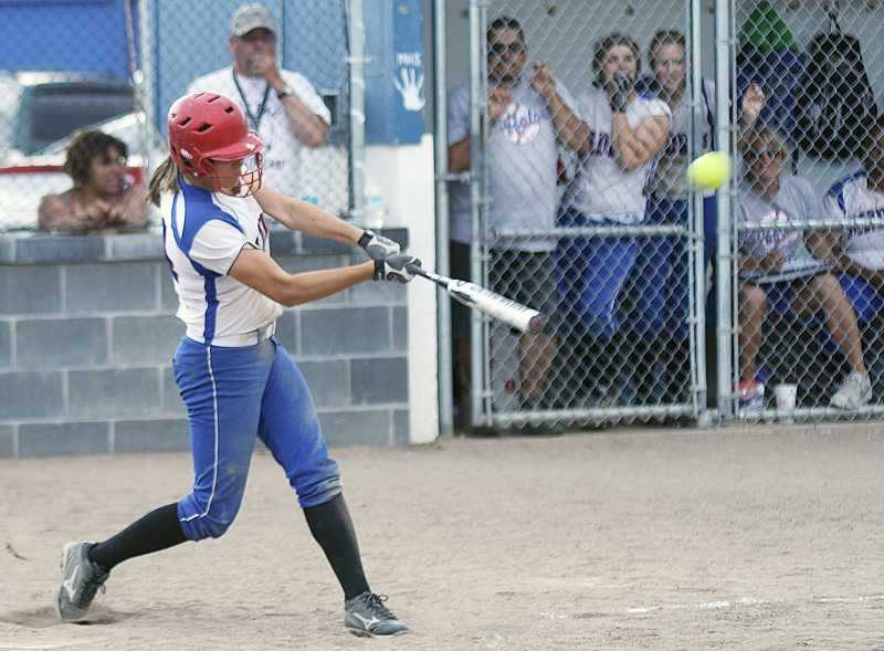 by: PIONEER FILE PHOTO - Madras infielder Sarah Brown, seen here belting a three-run home run against North Marion earlier in the season, was named to the Class 4A all-state second team as an infielder.