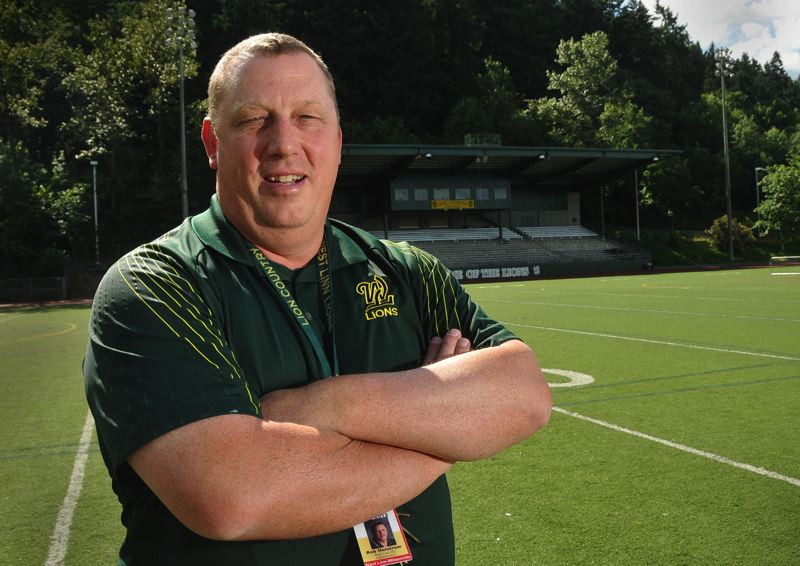 by: VERN UYETAKE - After 14 years as West Linn High's athletic director, Rob Holstrom is retiring.