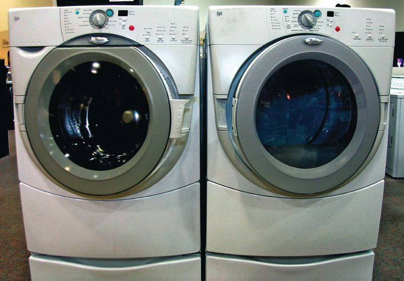 by: FILE PHOTO - Front-loading clothes washers dont require as much water to wash or rinse as older top-loaders, and they wring more moisture out of clothes before its time to dry them.