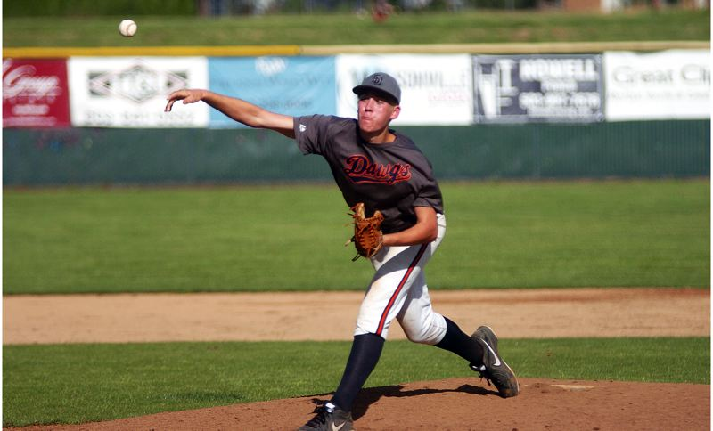 by: DAN BROOD - NO-HIT PITCHER -- Suburban Door pitcher Jacob Bennett fires a pitch to the plate during the Dawgs' OIBA game with West Linn last Thursday. Bennett threw a no-hitter in Suburban Door's 6-0 victory.