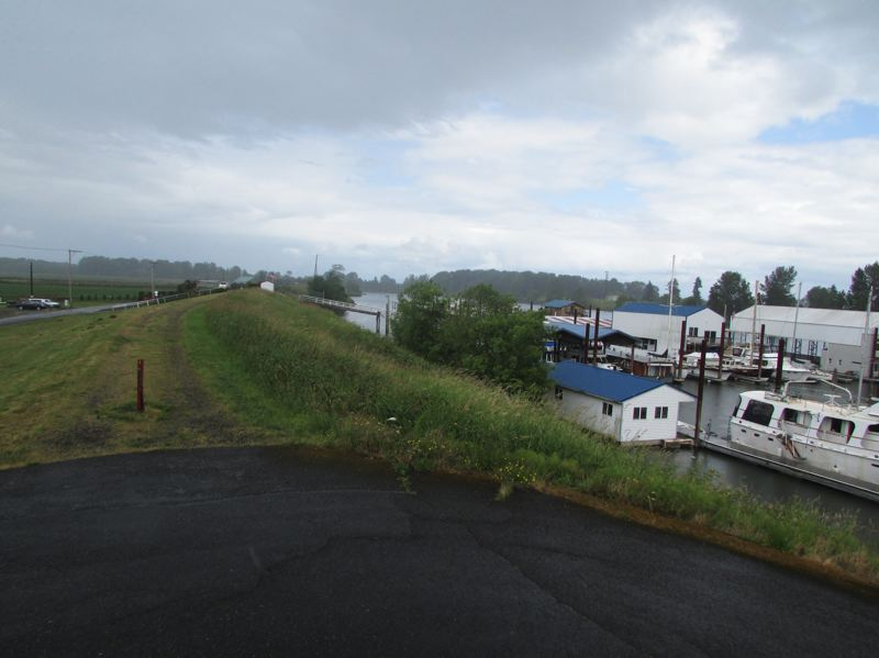 by: SPOTLIGHT PHOTO: ROBIN JOHNSON - Without certification, FEMA will classify 5,700 acres now shielded by the 9.9-mile long Scappoose levee as being in a flood zone.