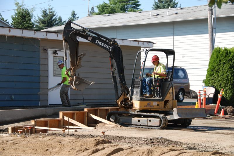 by: COURTESY OF PORTLAND RESCUE MISSION - Several Portland-area construction companies donated time and material to a $1.2 million renovation and expansion of the Portland Rescue Mission's Harbor facility on Northeast Wygant Street. The facility was opened Thursday, June 13, as one of the biggest projects by the Home Builders Foundation.