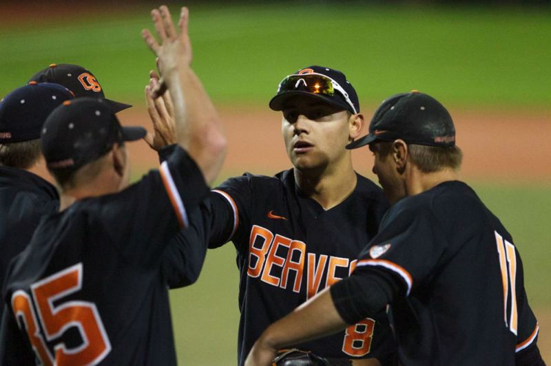by: TRIBUNE FILE PHOTO: JAIME VALDEZ - Michael Conforto (second from right) had a near-perfect day Saturday in Oregon State's 5-4 College World Series loss to Mississippi State.
