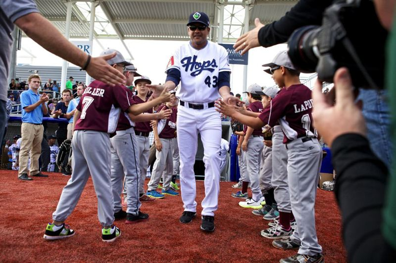 by: TRIBUNE PHOTO: JAIME VALDEZ - Hillsboro Hops manager Audo Vicente is introduced before the team's home opener.