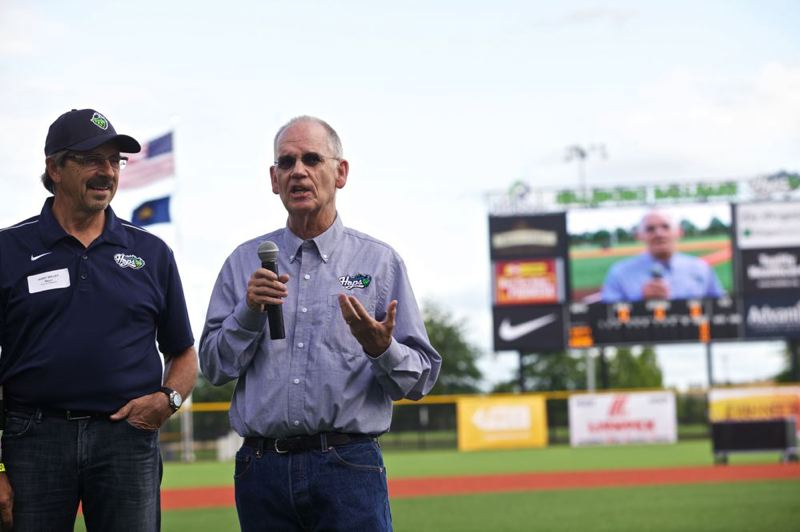 by: TRIBUNE PHOTO: JAIME VALDEZ - Hillsboro Mayor Jerry Willey (left) listens as Hillsboro Hops President Mike McMurray speaks to the crowd before the first pitch at Hillsboro Ballpark.