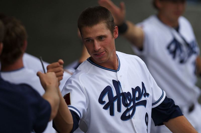 by: TRIBUNE PHOTO: JAIME VALDEZ - Shortstop Josh Parr celebrates with teammates in the dugout after scoring the first run at home for the Hillsboro Hops, who went on to beat the Eugene Emeralds 12-0 Monday night.