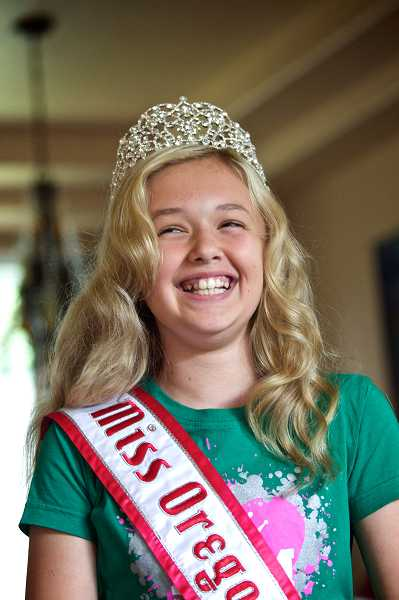 by: TIMES PHOTO: JAIME VALDEZ - Kennedy Hjelte models her Miss Oregon Pre-Teen Queen tiara and sash in her Tualatin home.