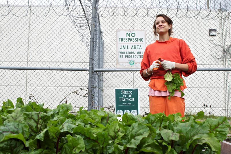 by: TRIBUNE PHOTO: JAIME VALDEZ - Inmate Caren Sargent of Raleigh Hills pauses while working on the Multnomah County Inverness Jails organic garden. The garden is part of the countys Sustainable Jail initiative.