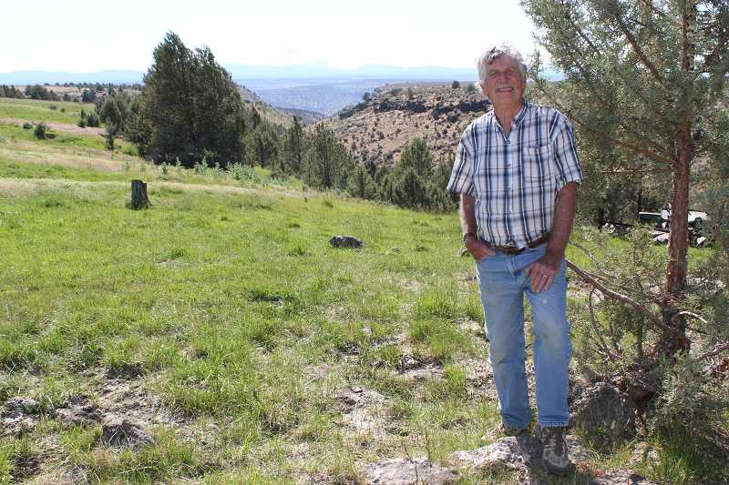 by: HOLLY M. GILL - Jerry Ramsey stands on his property, above the area he hopes will be called John Brown Canyon.