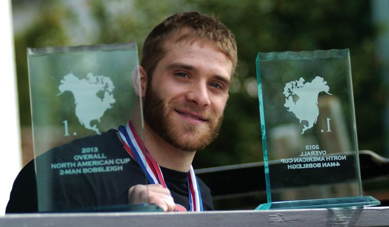 by: THE OUTLOOK: DAVID BALL - Barlow High graduate Sam Michener poses with some trophies won at the North American Cup last season. He is attempting to make the U.S. Olympic bobsled team for the Games in Russia.