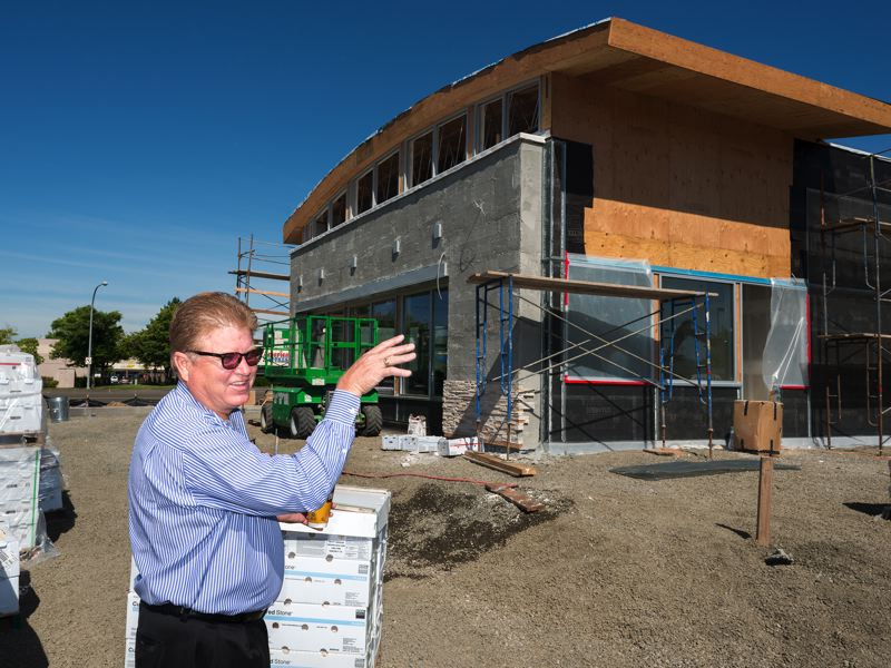 by: HILLSBORO TRIBUNE PHOTO: CHASE ALLGOOD - McDonalds owner Don Armstrong points out where artistic sculptures and attractive landscaping will spruce up the appeal of his renovated restaurant on 185th Avenue.