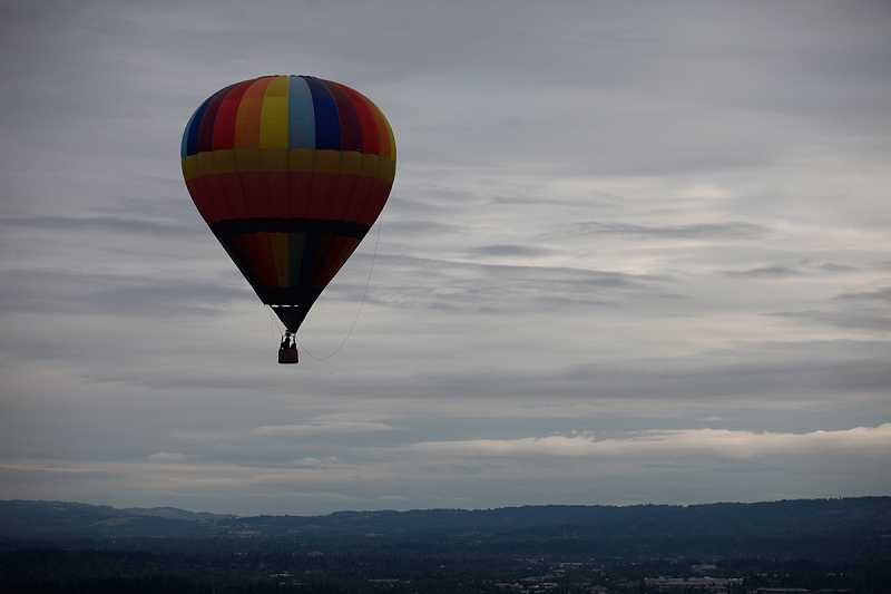 by: JONATHAN HOUSE - 'Persistence' hovers above Cook Park during the Tigard Festival of Balloons.