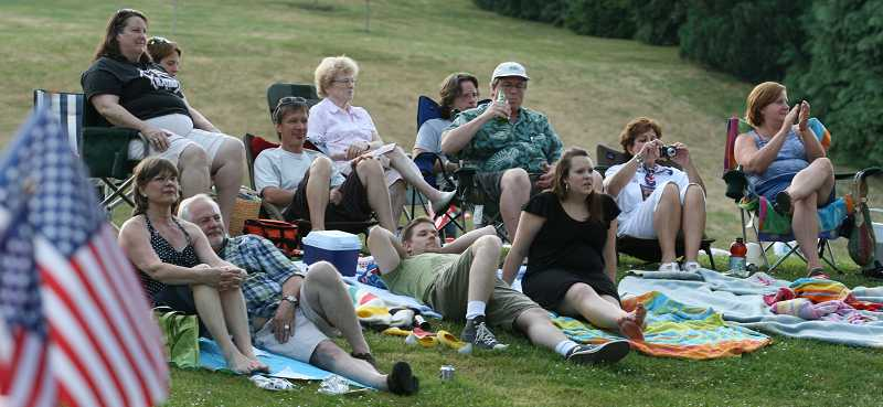 by: TIDINGS FILE PHOTO - A crowd watches the festivities during one of Alice Richmond's past Fourth of July celebrations.