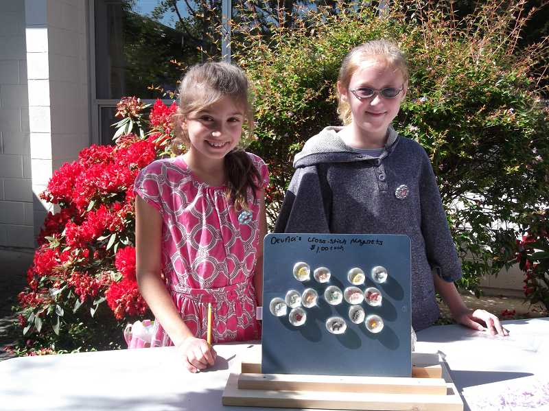 by:  KATE HOOTS - Devna Howard and Lauren Ulwelling, both fourth-graders, shared a booth, selling handcrafted items such as cross-stitch magnets.