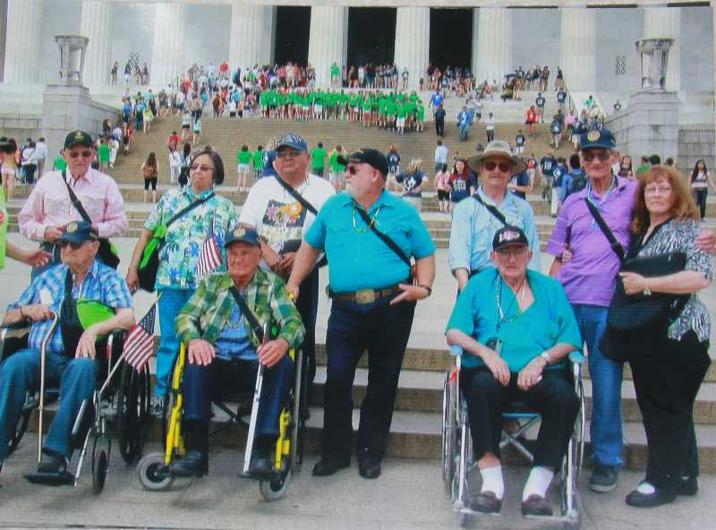 The group stopped for a photo during a tour of the U.S. Capitol. From back left, Loyal Miller, Janice Smith, Larson Kalama Sr., David Gibson, Leroy Ellis, Malcolm Griswold, and Doris McLean. Front left, Earnie Walston, Frank Lake and Bud Helmholts.