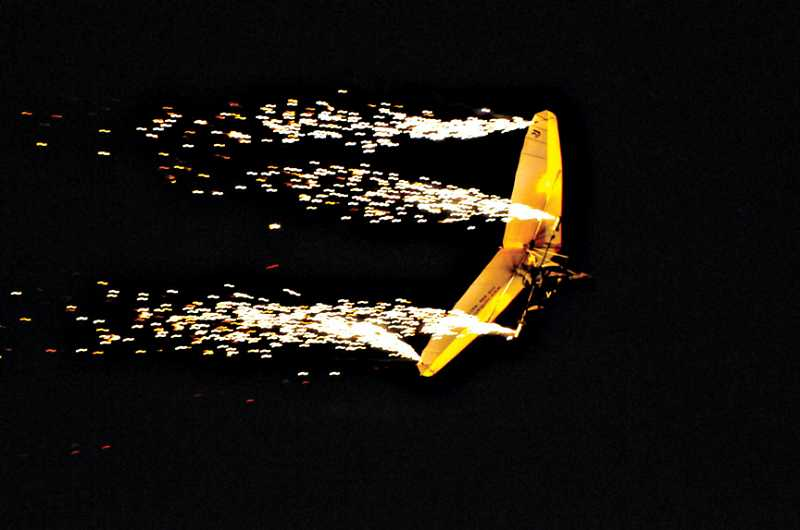 by: PHOTO BY TOM BROWN - Dan Buchanan, a paraplegic pilot, does an array of aerobatics. Buchanan, who brought his 'glider on fire' performance to the 2009 show, will be back for this year's event.