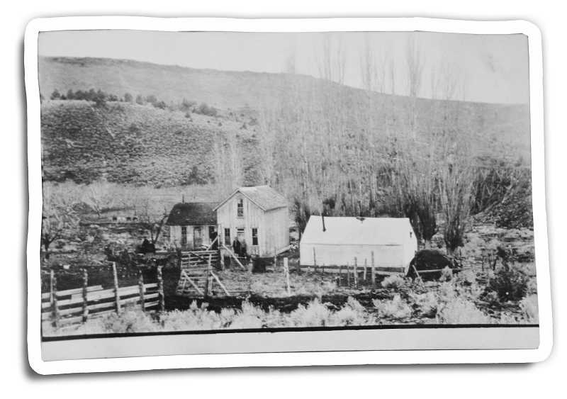 by: SUBMITTED PHOTO - Sarah Campbell, the wife of pioneer homesteader Ed Campbell, was an early photographer, who took this photo of the old John Brown house and farm around 1910.