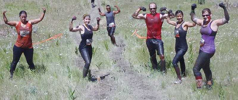 by: SUMBITTED PHOTO - Local participants of Tough Mudder Oregon flex their muscles while on the course. From left to right are Carino Bautista, Rosie Riley, Rudy Loredo, Tim Bewley, Martha Bewley and Jodi Burch. A team member not pictured, Michael Riley, snapped the photo.