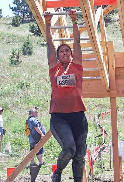 by: SUMBITTED PHOTO - Carino Bautista tries to work through the Funky Monkey obstacle during the Tough Mudder Oregon competition.