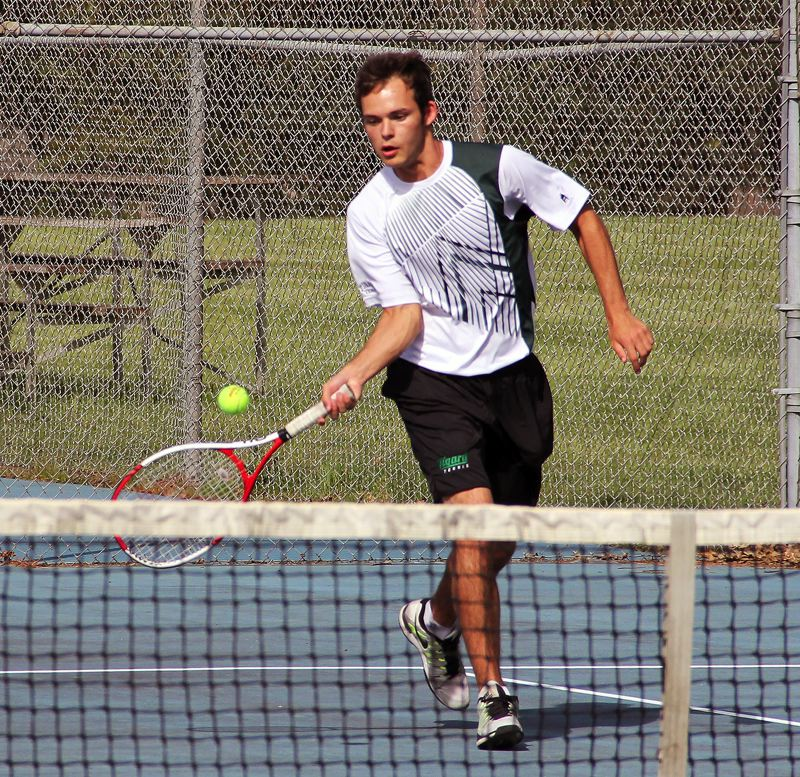 by: SUBMITTED PHOTO - AT THE NET -- Brian Josephson played at No. 1 doubles for the Tigard boys tennis team.