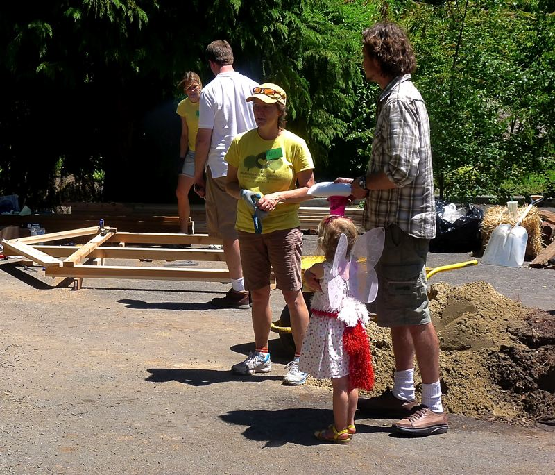 by: CONNECTION PHOTO: DREW DAKESSIAN - A young Multnomah Playschool student surveys the construction on her school's new playground June 8.