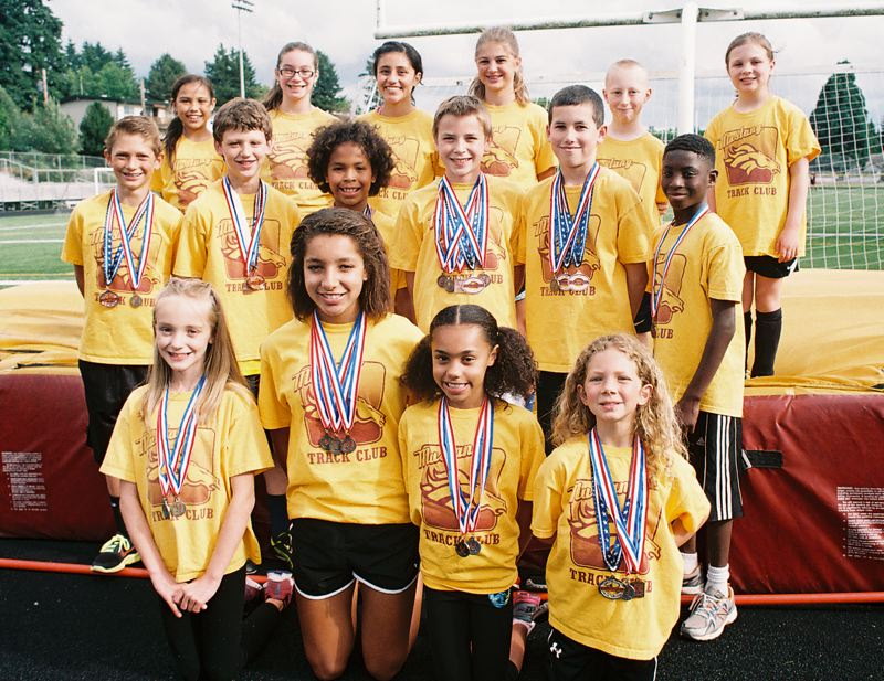 by: JOHN DENNY - Mustang Track Club athletes display their medals and ribbons from the 2013 state club and state Junior Olympic championship meets. Pictured are: (first row, from left) Isabella Vaughn, Tieara Norman, Deshanae Norman and Natalia Chianello; (second row) Cross Chianello, Shane Halladin, Kaylie Burdette, Ben Scheible, Wesley McGuire and Charles Dayton; and (back) Natasha Rodriquez, Shyla Theel, Karla Herrera, Hana Herschberger, Layne McArthur and Lola McArthur.