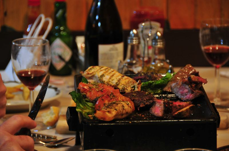 by: PHOTOS COURTESY: GAUCHOS - Gaucho's Argentine Cuisine serves one of its most popular dishes, the 'Parrilla para dos,' enough grilled meat to share.