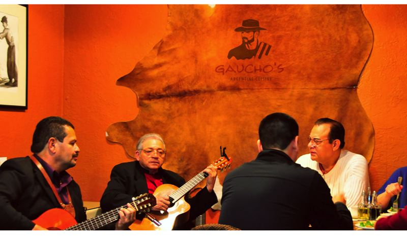 by: PHOTOS COURTESY: GAUCHOS - Guitarists often serenade evening diners at Gaucho's Argentine Cuisine.