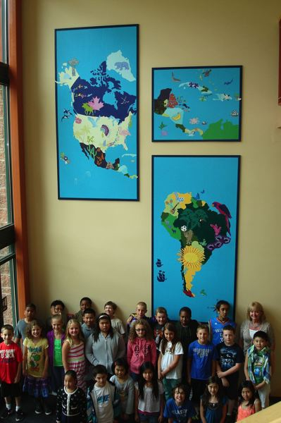 by: PHOTO COURTESY: NCSD - Scouters Mountain Elementary students celebrate their diversity by creating a set of large murals depicting their many countries of origin.