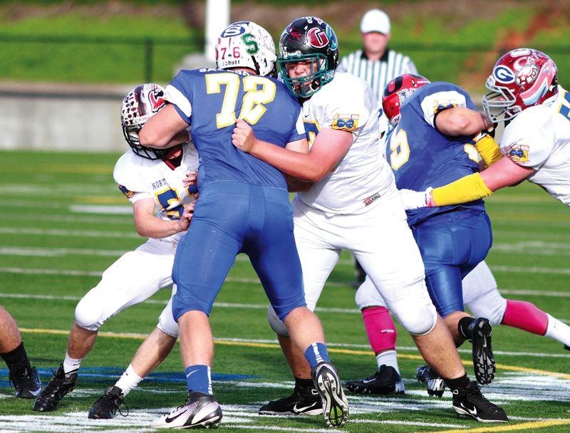 by: HILLSBORO TRIBUNE PHOTO: CHASE ALLGOOD - Century offensive lineman Alex Sirois (77) blocks Redmond's Sumner Saulsbury during Saturday's Les Schwab Bowl at Hillsboro Stadisum.